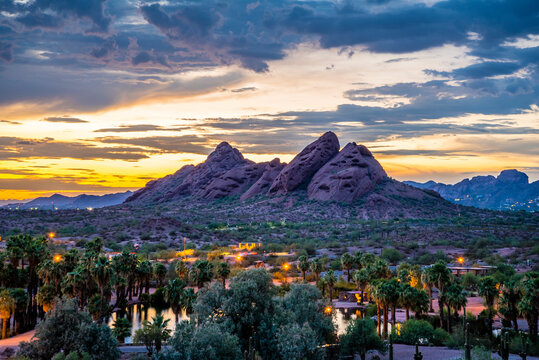 The red sandstone buttes of Papago Park in Arizona after sunset.
