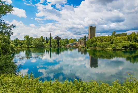 Garden of Ninfa, (Lazio, Italy) - A natural monument with medieval ruins in stone, flowers park and an awesome torrent with little fall. Province of Latina, central Italy. Here the little lake.