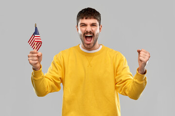 independence day, patriotism and national people concept - shouting young man in yellow sweatshirt...