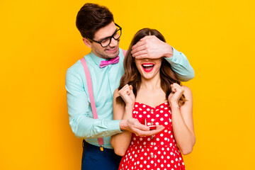 Two people crazy overjoyed girl man hide her eyes give jewelry ring ask marry him betrothal...