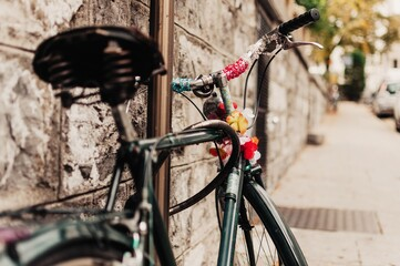 Vintage bike with flowers parked in the street