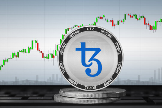 Tezos XTZ cryptocurrency; Tezos coin on the background of the chart