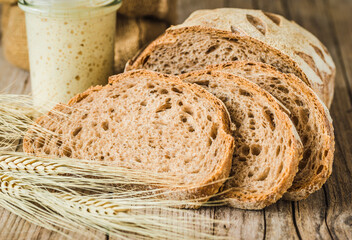 Bakery rustic loaf of bread on rustic wooden background copy space and sourdough.