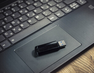 USB flash drive on a laptop containing important data. A portable storage symbol