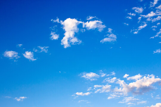 bright puffy clouds on the azure sky. wonderful nature background in summertime