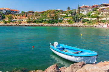 nessebar, bulgaria - SEP 02, 2019: boats in harbor of an old town. popular travel destination. wonderful sunny weather. vintage fishermen houses and old architecture in the distance