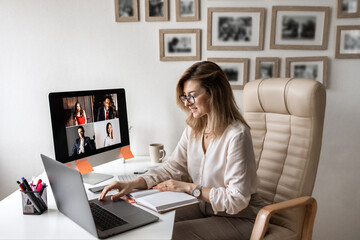 Obraz Video business conference. Young director holds a video conference from home. - fototapety do salonu