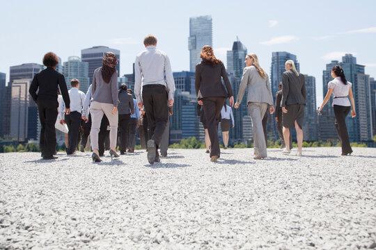 Business people walking toward city