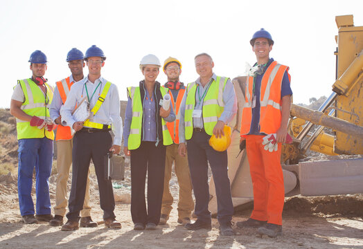 Workers and business people smiling at quarry