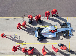 Printed roller blinds F1 Racing team working at pit stop