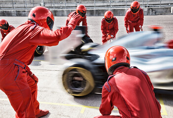 Acrylic Prints F1 Racing team working at pit stop