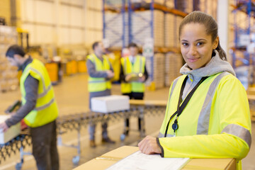 Fototapeta Worker smiling in warehouse obraz