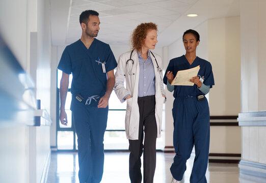 Hospital staff talking in hallway