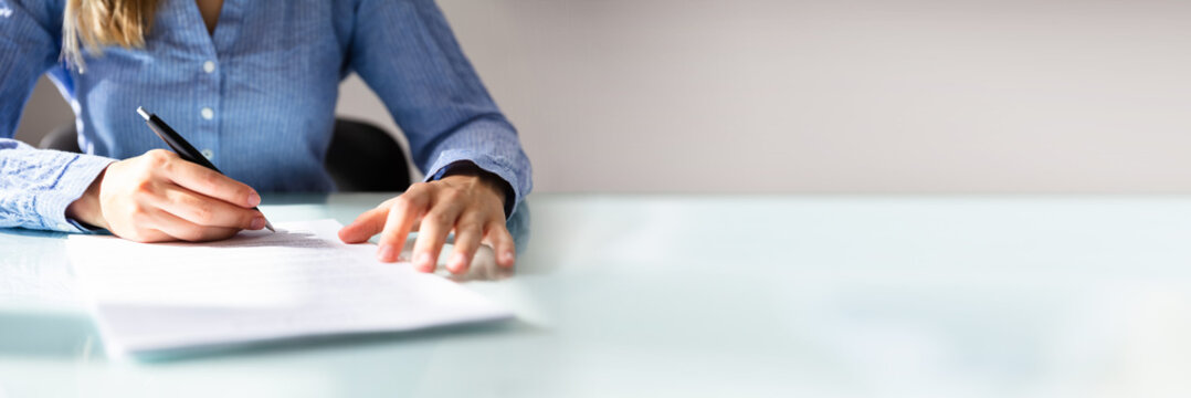 Businesswoman's Hand Signing Contract