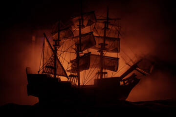 Fotorolgordijn Schip Black silhouette of the pirate ship in night