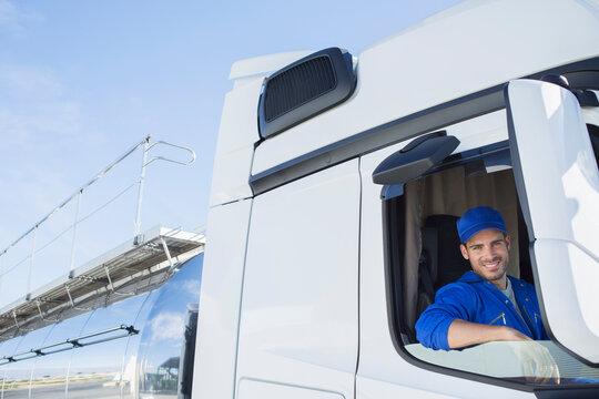 Portrait of smiling driver in milk tanker