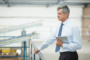 Supervisor with digital tablet in food processing plant