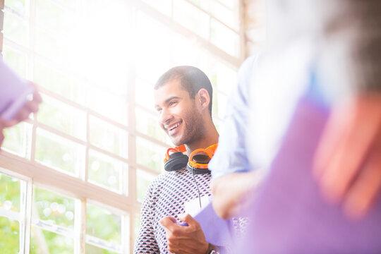 Smiling man talking in meeting
