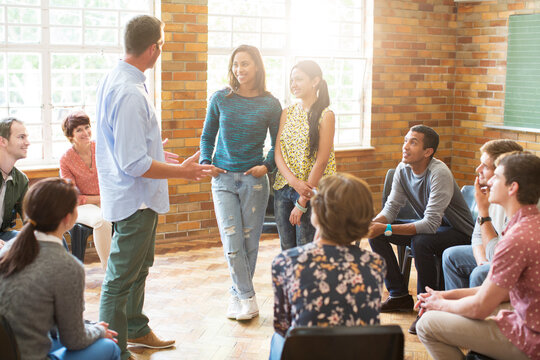 Man and women talking in group therapy session
