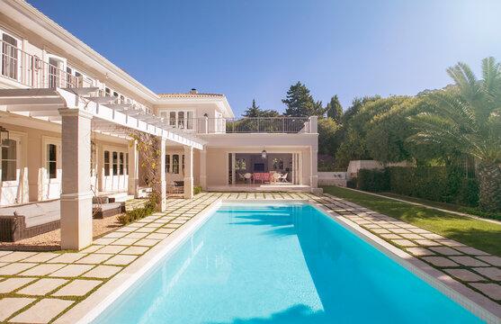 Lap swimming pool along luxury house