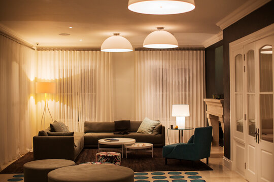 Illuminated domed lights over home showcase living room