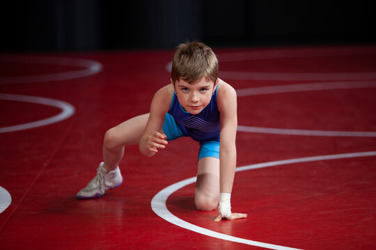 Young female wrestler in a blue singlet