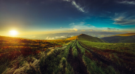 Deurstickers Landschappen Amazing mountain landscape with colorful vivid sunset on the cloudy sky. Beauty world
