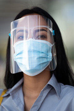 Asian woman are protected by Covid 19, and he wears a face shield mask.