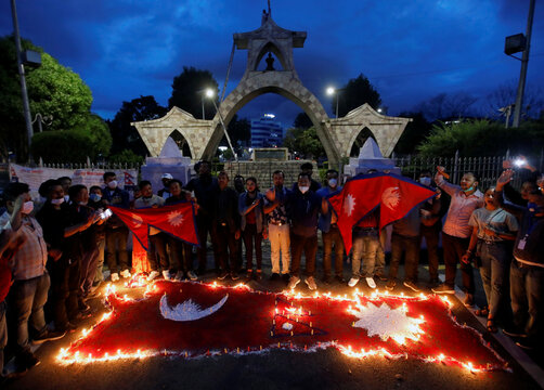 Nepalese people celebrate after the parliament approved a new map of the country, in Kathmandu