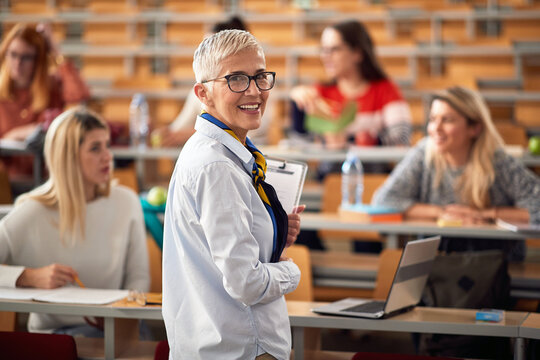 Female elderly professor giving a lecture