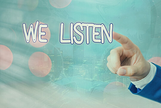 Writing note showing We Listen. Business concept for an organization willing to pay attention by offering their ears