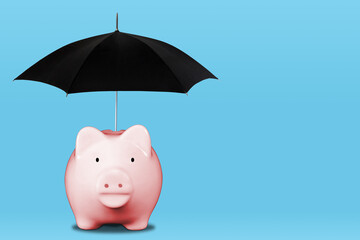 Saving For a Rainy Day Concept With Piggy Bank Shielded From Rain