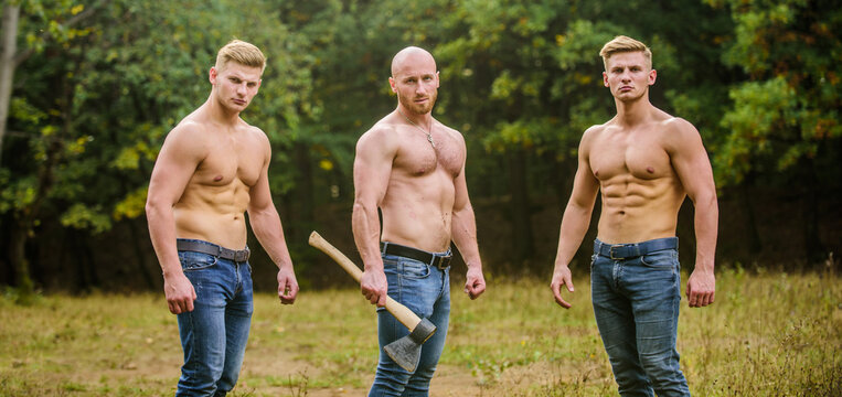 Never stop. Sports and leisure. mesomorph. three muscular men with axe. athletic man use ax. bodybuilders in jeans. Three sexy guys. brutal guys pose with naked torso. handsome guys with sexy body