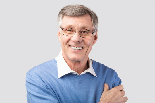 Portrait Of Senior Man Smiling Looking At Camera, Studio Shot