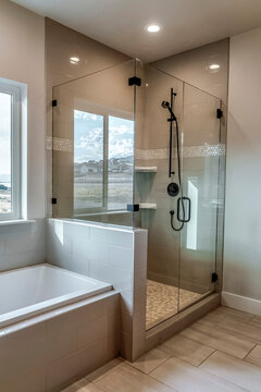 Rectangular walk in shower stall with half glass enclosure and black shower head