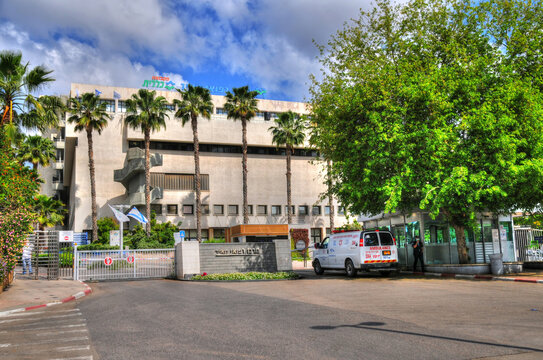 """KFAR SABA (KEFAR SAVA), ISRAEL, APRIL  29, 2020: ambulance at the entrance of the """"MEIR"""" MEDICAL CENTER  having a countrywide reputation for its treatment of pulmonary diseases and spinal surgery."""