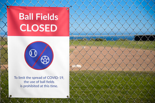 Malibu, CA - June 13, 2020: Sign posted at baseball fields in Malibu park. To slow the spread of COVID-19, soccer and ball fields are closed and sports play is prohibited.