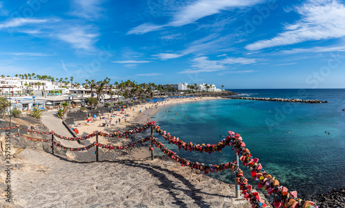 Wall mural Lanzarote, Spain - October 8, 2019: Landscape with turquoise ocean water on Flamingo beach, Lanzarote, Canary Islands, Spain