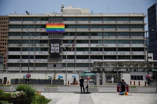 A huge Black Lives Matter banner is seen below a LGBT pride flag at the U.S. embassy in Seoul