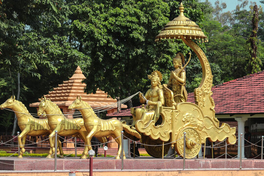 Golden statue of krishna and arjun at CG shashwat Dham , chitwan, Nepal .