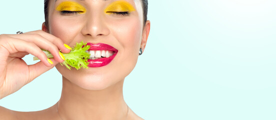 Healthy eating, diet. Beautiful healthy girl eating raw vegan food and smiling. Beauty young...