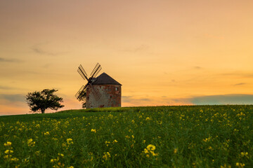 Old windmill in the field at sunset. Moravia, Czech Republic