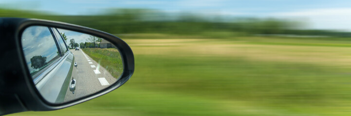 Car driving on the road with motion blur background