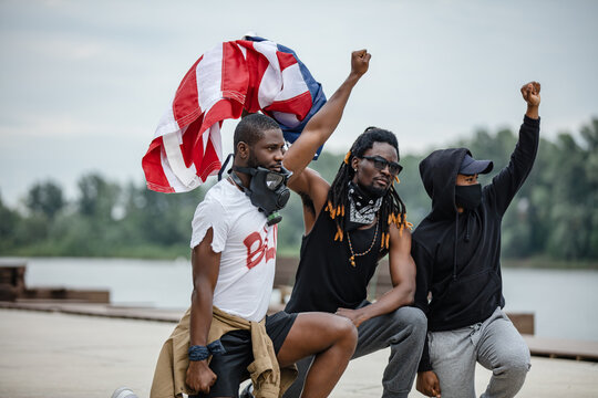 Portrait of three men protesting