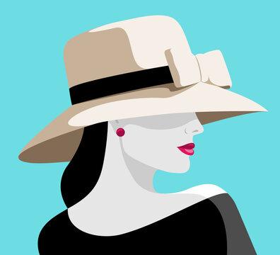 Elegant woman wearing big hat