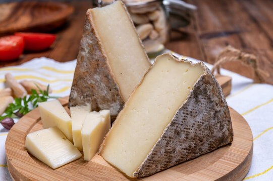 Cheese tomme de montagne or tomme de savoie made from cow milk in French Alps.