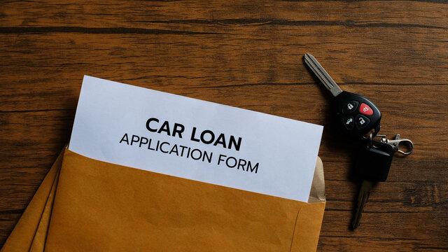 Car loan application form with car keys on wood background.