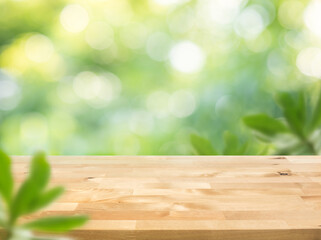 Real wood table top texture on blur leaf tree garden background