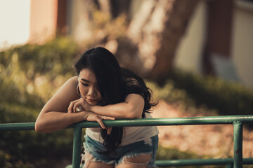Beautiful thai woman very sad from unrequited love,She rethink and think over about love,vintage style,dark tone,broken heart,asian girl think a lot because she fat