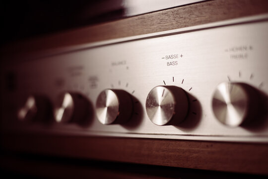 Silver wooden vintage amplifier: Close up of control knobs